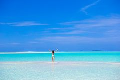 Young woman enjoy tropical beach vacation Stock Images