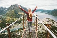 Young woman enjoying aerial mountains view Royalty Free Stock Photo