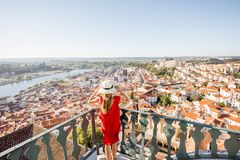Woman traveling in Coimbra city, Portugal. Young woman enjoying aerial view on the old town of Coimbra city during the sunset in the central Portugal stock images