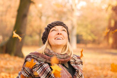 Young woman enjoying autumn. Young woman enjoying sunny day in autumn in the park Royalty Free Stock Image