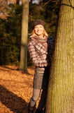 Young woman enjoying autumn. Young woman enjoying sunny day in autumn in the park Stock Photos