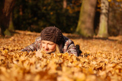 Young woman enjoying autumn. Young woman enjoying sunny day in autumn in the park Royalty Free Stock Photo