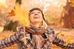 Young woman enjoying autumn. Young woman enjoying sunny day in autumn in the park Royalty Free Stock Photography