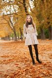 Young woman enjoying autumn day. Young woman enjoying beautiful autumn day royalty free stock photos