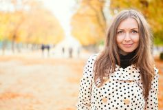 Young woman enjoying autumn day. Young woman enjoying beautiful autumn day stock images