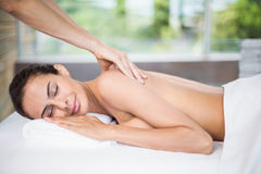Young woman enjoying back massage Stock Image
