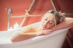 Young woman enjoying bath Stock Image
