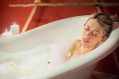 Young woman enjoying bath Royalty Free Stock Photo