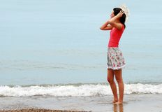 Young woman enjoying the beach Royalty Free Stock Photography