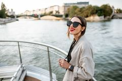Woman enjoying landscape view on Paris city from the boat royalty free stock image