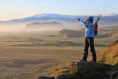 Young woman enjoying the beauty of Iceland landscape Stock Images
