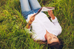 Young Woman Enjoying Book Reading Outdoors Royalty Free Stock Image