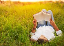 Young Woman Enjoying Book Reading Outdoors Royalty Free Stock Photos