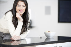 Young woman enjoying breackfast Stock Photography