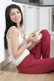 Young woman enjoying breakfast Stock Photos