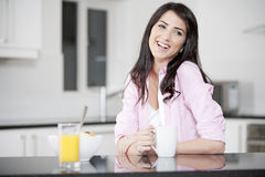 Young woman enjoying breakfast Royalty Free Stock Photos