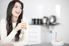 Young woman enjoying breakfast Royalty Free Stock Image