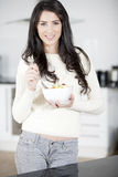 Young woman enjoying breakfast Royalty Free Stock Photo