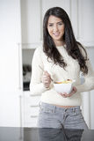 Young woman enjoying breakfast Stock Images