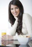 Young woman enjoying breakfast Royalty Free Stock Photos