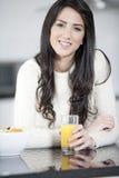 Young woman enjoying breakfast Royalty Free Stock Image