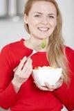 Young woman enjoying breakfast Stock Image