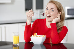 Young woman enjoying breakfast Royalty Free Stock Photography