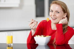 Young woman enjoying breakfast Stock Photo