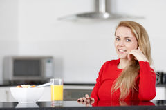 Young woman enjoying breakfast Royalty Free Stock Photo