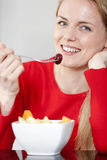 Young woman enjoying breakfast Stock Images