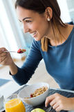 Young Woman Enjoying Breakfast in the kitchen Royalty Free Stock Photo