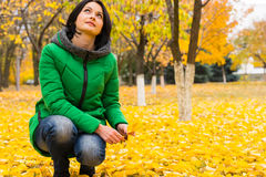 Young woman enjoying bright yellow autumn leaves Royalty Free Stock Photos
