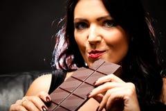 Young Woman Enjoying Chocolate Royalty Free Stock Photos