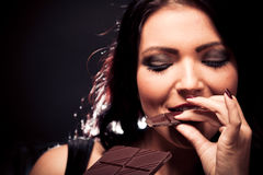 Young Woman Enjoying Chocolate Royalty Free Stock Images