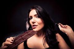 Young Woman Enjoying Chocolate Royalty Free Stock Photography