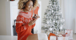 Young woman enjoying a Christmas treat Stock Photography