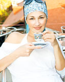 Young woman enjoying a coffee Stock Photo