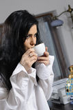 Young woman enjoying coffee Royalty Free Stock Photos