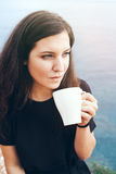 Young woman enjoying coffee Royalty Free Stock Images