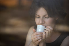 Young woman enjoying coffee Royalty Free Stock Photography