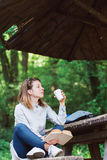 Young woman enjoying coffee and reading book Stock Photos