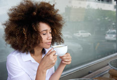 Young woman enjoying cup of coffee Royalty Free Stock Photography
