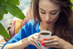 Young woman enjoying a cup of coffee Stock Photos
