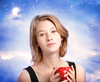 Young woman enjoying a cup of coffee Stock Images