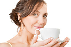 Young woman enjoying a cup of tea Stock Image