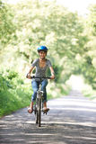 Young Woman Enjoying Cycle Ride In Countryside Royalty Free Stock Photo