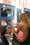 Young Woman, Driving Simulator, Video Game, Red Haired  Royalty Free Stock Images