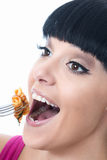 Young Woman Enjoying Eating Tomato Pasta with Wide Eyed Expression Royalty Free Stock Photography