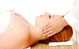 Young woman enjoying facial massage Stock Photos