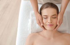 Young woman enjoying of facial massage. In spa salon Royalty Free Stock Photography